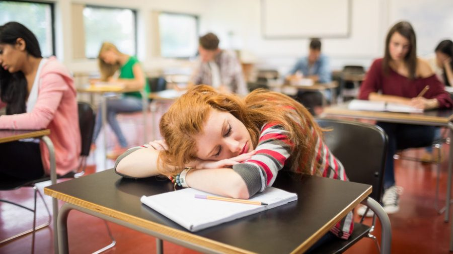 Instead of paying attention in class, all this student can think about is her comfy bed and soft pillows back at home.