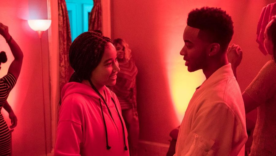 Starr (Amandla Stenberg) and Khalil (Algee Smith) reunite at a Garden Heights Party.