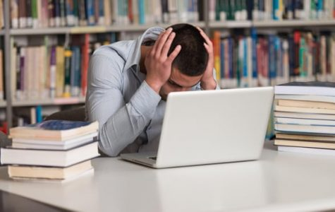 A student stressing over the amount of work he needs to get done.   Photo credit: theguardian.com