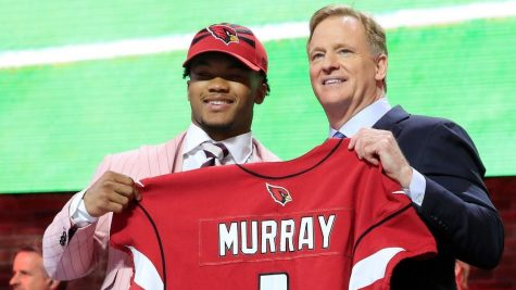 Kyler Murray, the first overall pick in the 2019 NFL draft, holds his new Arizona Cardinals.